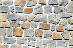 Fragment of rough stone wall Stock Photos