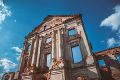 Fragment of ruined castle on blue sky Stock Photography