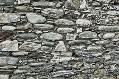 Fragment of the ruined stone wall Stock Photography