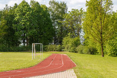 Fragment of running track in the village Stock Photos