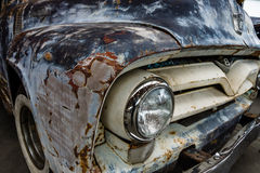 Fragment of rusted body of full-size pickup truck Ford F100 Royalty Free Stock Photo