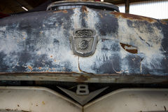 Fragment of rusted body of full-size pickup truck Ford F100 Stock Image