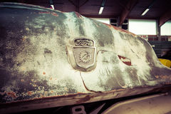 Fragment of rusted body of full-size pickup truck Ford F100. Royalty Free Stock Photography