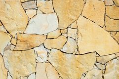 Fragment of a sandstone wall Stock Images