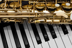 Fragment of the saxophone Stock Images