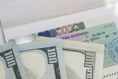 Fragment of Schengen visa in passport and money. Royalty Free Stock Image