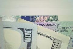 Fragment of Schengen visa in passport and money. Stock Image