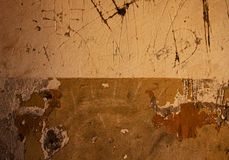 Fragment of scratched plaster wall background. With simbols Stock Image