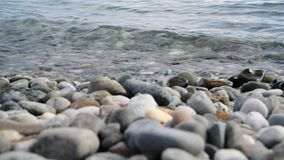Fragment of sea coast with a pebble beach stock video footage