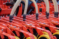 Fragment of a seeder. With grain feeding hoses Royalty Free Stock Images