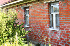 Fragment of shabby brick village house Stock Photo