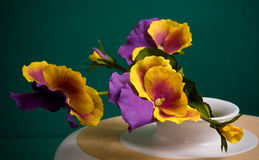 Fragment of shallow ceramic vase with pansy Royalty Free Stock Photos