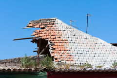 Fragment shattered the tiled roof of house Royalty Free Stock Image