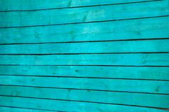 Fragment the shield of parallel horizontal old wooden boards painted in green royalty free stock photo
