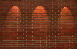 Fragment of the shined brick wall. With three spot light Stock Photo