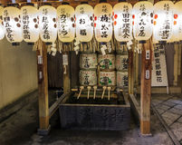 Fragment of a shinto shrine with purification ladles, sake offer Royalty Free Stock Photo