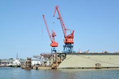 Fragment of ship dock with port cranes. City Svetlyj, Kaliningrad region stock photo