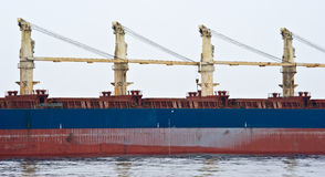 Fragment of a ship with hydraulic cranes on board. Royalty Free Stock Photography