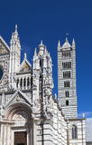 Fragment of Siena cathedral in a sunny day, Tuscany, Italy Stock Photos