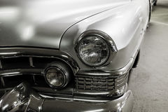 Fragment silver vintage car. Fragment of beautiful shiny silver vintage car Royalty Free Stock Photo