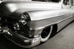 Fragment silver vintage car. Fragment of beautiful shiny silver vintage car Stock Image