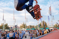 Fragment of a skateboarder, who makes ollie stunt at Moscow City Games Red Bull contest Stock Photo