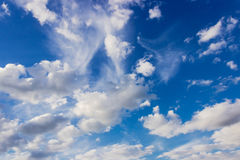Fragment of sky with cumulus clouds and cirrus cloud Stock Image