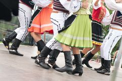 Fragment of Slovak folk dance with colorful clothes. In Folk Festival stock images