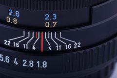 Fragment of an SLR lens. Close-up of the  fast lens aperture and focusing ring Stock Photography
