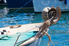 Fragment of small fishing boat with bow winch Stock Photography