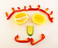 Fragment of smiling plate. With a vegetable mug Royalty Free Stock Images