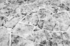 A fragment of a snow-covered road from a flat stone as the basis of the background. stock photography