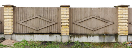 Fragment of a solid fence in rural style Stock Photography