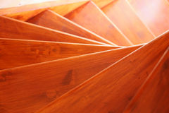 Fragment of a spiral wooden staircase Stock Image