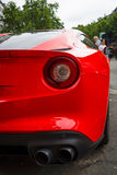 Fragment of sports car Ferrari F12berlinetta. Rear view. Stock Photo
