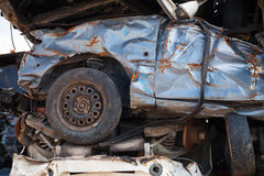 Fragment of stacked cars in junkyard Stock Photography