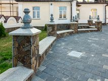 Fragment of a stone fence of a beautiful design in Pochaev Lavra stock image