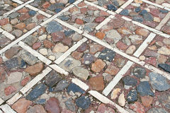A fragment of the stone pavement Royalty Free Stock Photo