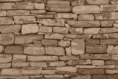 Fragment of a stone wall closeup of sepia color Royalty Free Stock Photos