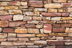 Fragment of a stone wall closeup Royalty Free Stock Photography