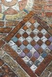 Fragment of stone wall with old tiles Stock Photos
