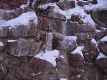 A fragment of a stone wall.Texture.Old and ancient Stock Photo