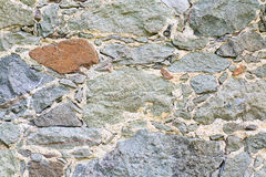 Fragment of stony wall (background) Stock Photo