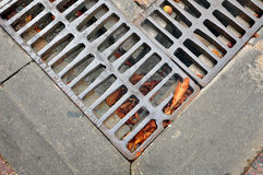 Fragment of street drainage. Stock Photos