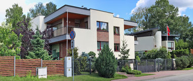 Fragment of the street, fence  and modern elite  apartment buil Stock Image