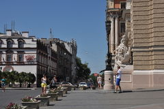 Fragment of streets, buildings Opera House and other buildings, passers people Stock Image