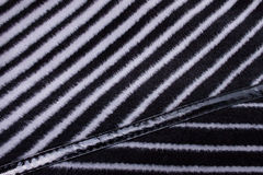 Fragment of Striped Coat with Leather Decoration Royalty Free Stock Photo