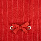 Fragment of a striped red cloth. Fabric with the bow-knot in the middle as a background texture Stock Photo