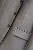Fragment of suit. Fragment of gray men's suit, close-up Stock Image
