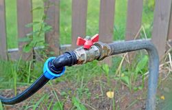Fragment of a summer elevated water supply system stock photos